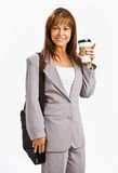 Businesswoman drinking coffee. Businesswoman standing with a laptop bag and a cup of coffee Stock Image