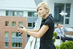 Businesswoman drinking coffee Royalty Free Stock Image
