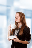 Businesswoman drinking coffee Stock Image