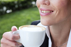 Businesswoman drinking coffee Stock Images