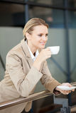 Businesswoman drinking coffee Royalty Free Stock Images