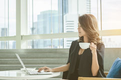 Businesswoman Drinking Coffee At Office Royalty Free Stock Photography