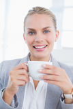 Businesswoman drinking coffee behind her computer Royalty Free Stock Photography