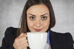 Businesswoman drinking coffee on break Stock Images
