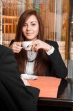 Businesswoman drinking coffee. At the business summit Stock Photo