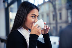 Businesswoman drinking coffee in cafe Stock Photo