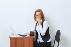 Businesswoman drinking coffee in front of her Stock Photography