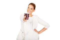 Businesswoman drinking coffee from paper cup.  Stock Photos