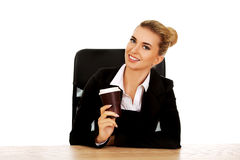 Businesswoman drinking coffee from paper cup behind the desk Stock Image