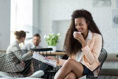 Businesswoman drinking coffee in restaurant Royalty Free Stock Photography