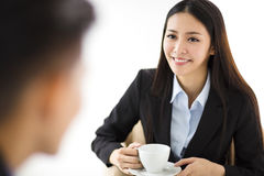 Businesswoman  drinking coffee and talking with businessman Royalty Free Stock Image