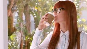 Businesswoman drinking coffee to go
