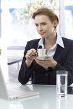 Businesswoman drinking coffee royalty free stock photo