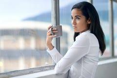 Businesswoman drinking cofffee Stock Photo