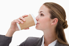 Businesswoman drinking a takeaway coffee Stock Image
