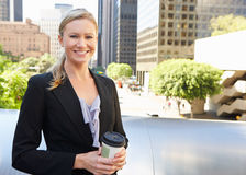 Businesswoman Drinking Takeaway Coffee Outside Office Royalty Free Stock Image