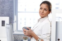 Businesswoman drinking tea Stock Photography