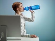 Businesswoman drinking water stock photo