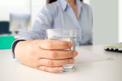 Businesswoman drinking water at office Royalty Free Stock Images