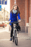 Businesswoman drives on bike Royalty Free Stock Images