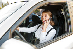 Businesswoman driving the car Royalty Free Stock Photos