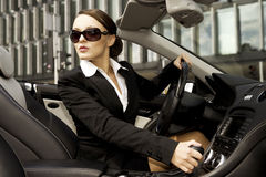 Businesswoman driving a car Stock Photography