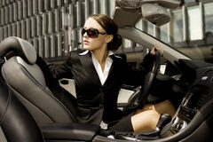 Businesswoman driving a car Royalty Free Stock Image