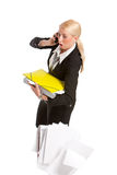 Businesswoman dropping all her papers Royalty Free Stock Image