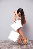 Businesswoman dropping folders on the floor Royalty Free Stock Image