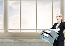 Businesswoman dropping many folders Stock Photography