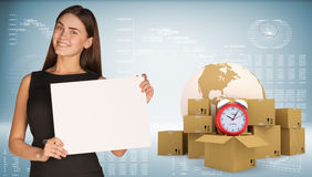 Businesswoman with Earth, alarm clock and Stock Photos