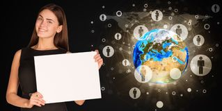 Businesswoman with Earth and contacts Royalty Free Stock Photography