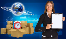 Businesswoman with Earth and heap of cardboard Stock Photo