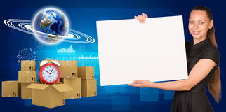 Businesswoman with Earth and heap of cardboard Royalty Free Stock Photography