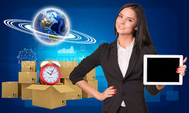 Businesswoman with Earth and heap of cardboard Royalty Free Stock Photos