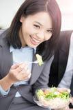 Businesswoman eat salad in office Stock Photos
