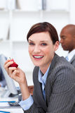 Businesswoman eating an apple in the office Royalty Free Stock Images