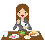 Businesswoman eating  Breakfast Royalty Free Stock Photography
