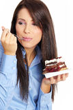 Businesswoman eating the cake Royalty Free Stock Photography