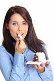 Businesswoman eating the cake Stock Image