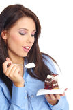Businesswoman eating the cake Stock Photo