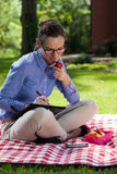 Businesswoman eating lunch outdoors Royalty Free Stock Photography