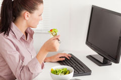 Businesswoman eating salad Royalty Free Stock Photo