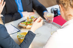 Businesswoman eating salad Stock Photography