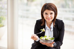 Businesswoman eating a salad Stock Photo