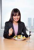 Businesswoman Eating Salad at Workplace Stock Photos