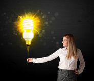 Businesswoman with an eco-friendly  bulb Stock Photo