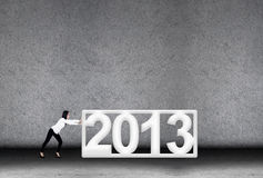 Businesswoman effort in 2013 for new year Stock Photo