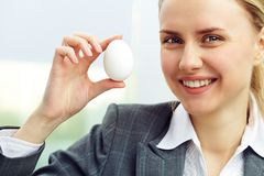 Businesswoman with egg Royalty Free Stock Photography
