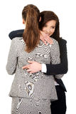 Businesswoman embrace woman with fingers crossed. Royalty Free Stock Images